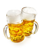 Two pint mugs of frothy cold beer Royalty Free Stock Photo