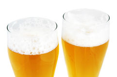 Two pints of beer. Isolated on white Stock Photo