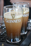 Two pints of beer served at The Guinness Brewery royalty free stock image
