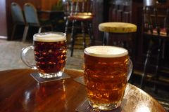 Two pints of beer in a typically traditional British pub Royalty Free Stock Photos