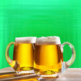 Two pints on the green background Stock Images