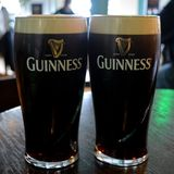 Two pints of guinness please. Two freshly poured pints of guinness from the guinness storehouse or factory dublin republic of ireland stock photos