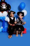 Two pirate. On a blue background Stock Image