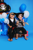 Two pirate. On a blue background Royalty Free Stock Photo