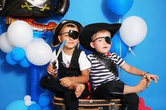 Two pirate. On a blue background Royalty Free Stock Photography