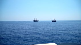 Two pirate sailing ship. Two pirate ships sail towards each other stock video footage