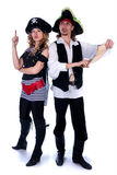 Two pirates. Two pirate men and a women holding a map in his hands Royalty Free Stock Photo