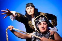 Two pirates on blue Stock Photo
