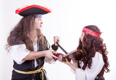 Two pirates fighting for box of tresure. Studio shooting Royalty Free Stock Image