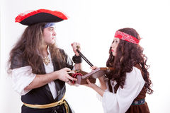 Two pirates fighting for box of tresure. Studio shooting Royalty Free Stock Images