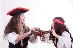 Two pirates fighting for box of tresure. Studio shooting Stock Photography