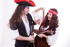 Two pirates found box of tresure. Studio shooting Stock Image