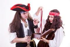 Two pirates found box of tresure. Studio shooting Royalty Free Stock Photography