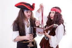 Two pirates found box of tresure. Studio shooting Stock Photo