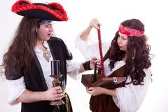 Two pirates found box of tresure. Studio shooting Royalty Free Stock Image