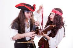 Two pirates found box of tresure. Studio shooting Royalty Free Stock Photos