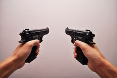 Two Pistols. A first-person perspective photo taken on hand holding two pistols. They are toy replicas Royalty Free Stock Photography