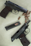 Two pistols. Bullets and Soviet Union made Makarov pistols Stock Images