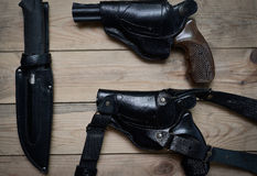 Two pistols and a knife Stock Photos
