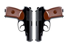 Two pistols symmetrically directed down the trunks royalty free stock photos