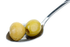 Two pitted green olives in the small spoon Royalty Free Stock Image