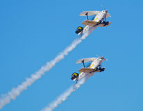 Two Pitts aerobatic aircraft in a formation climb Royalty Free Stock Images
