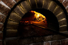 Two pizza in a wood burning oven Royalty Free Stock Images