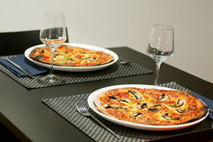 Two Pizzas. Two pizza. Served at restaurant table Royalty Free Stock Images