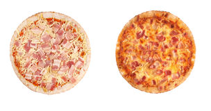 Two pizzas isolated, cooked and raw Royalty Free Stock Photos