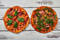 Two Pizzas On Wooden Background. Royalty Free Stock Photography