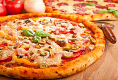 Two pizzas on a table Stock Images