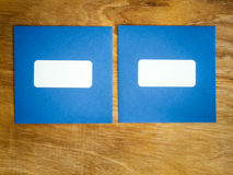 Two plain blue windowed envelopes side by side Royalty Free Stock Photo