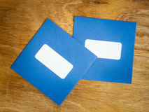 Two plain blue windowed envelopes Stock Photography