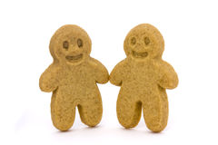 Two plain gingerbread men. On a white background Stock Image