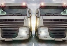 Two plain trucks on a highway Royalty Free Stock Images