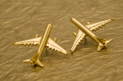 Two Planes. Close up of Two Planes on Gold Foil Background Royalty Free Stock Photos