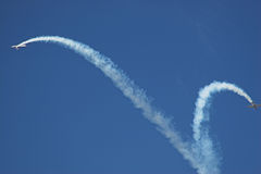Two planes. Performing in an air show royalty free stock image