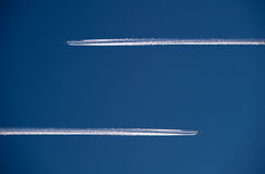 Two planes in the air. Two planes are flying in the air, both in another direction royalty free stock images