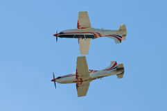 Two planes in flight. Very near together against blue sky Royalty Free Stock Image