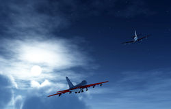 Two Planes Flying At Night 3. Two planes flying high in the moonlight sky Royalty Free Stock Images