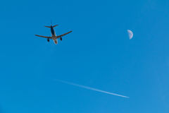 Two planes and moon in the sky Royalty Free Stock Photos