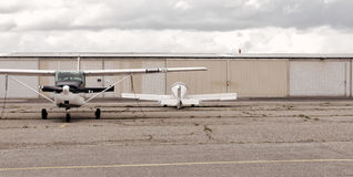 Two planes ready for flight. Two planes sit waiting for the next flight out from this small airport Stock Image