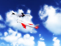 Two Planes In The Sky. Two planes flying high in the sky Royalty Free Stock Photo