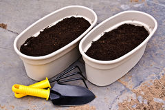 Two planters and garden tools Stock Images