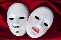 Two plaster masks. Female and male plaster masks on silk  fabric, close up Stock Photography