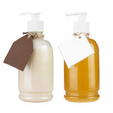 Two plastic bottles of body care Stock Photos