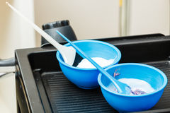 Two plastic bowls with bleach hair dye Stock Photo