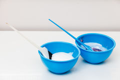 Two plastic bowls with bleach hair dye Royalty Free Stock Image