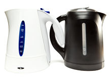 Two plastic electric tea kettle. Two electric tea kettle on a white background stock image
