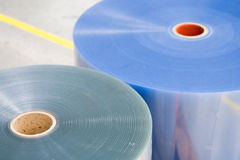 Two plastic rolls for packaging machin. E in warehouse royalty free stock image